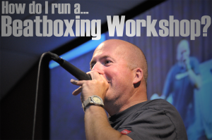 Man with a mic at a beatboxing workshop